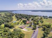 32586 Pebble Beach Street, Afton, OK 74331 - Image 1: Our subject property backs to the 18th fairway and is only a short chip shot away from the 18th green which is next to the pond and fountain in the middle left of this photo!!
