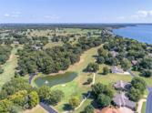 Pebble Beach Street, Afton, OK 74331 - Image 1: From the 1st box in this photo to the 18th green in this photo, the Coves Golf Club is an 18-hole championship golf course for golfers of all skill levels. The Club House is a short walk across the fairway from our subject property. The Golf Course is a fun 18 hole regulation course. From the championship tees it features 6,498 yards of golf for a par of 72. The course was designed by Brent Wadsworth/Randy Heckenkemper and opened in 1987.