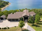 12532 Shoreline Drive, Skiatook, OK 74070 - Image 1: Rustic custom estate nestled on a 1.2 acre waterfront lot in the gated Estates at Cross Timbers on Skiatook Lake. Take the golf cart or ride the ATV trails to Cross Timbers Marina!