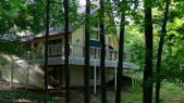 6913 Mountain Pass, Gaylord, MI 49735 - Image 1: Wrap-around deck and Walk-out