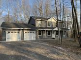 7715 Sandpiper Trail, Gaylord, MI 49735 - Image 1: Spring has arrived.